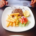 Steak with chunky chips and a salad