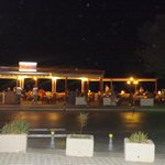 Front of hotel restarunts by night. Along the sea front.