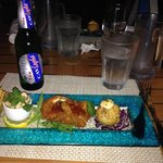 Lionfish Ceviche, Coconut Shrimp, Conch and Crocodile Fritter, and a Caybrew Light at Tukka....L