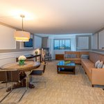 A Deluxe Suite Parlor, with dining area and wet bar