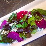 Mixed local greens salad, crumbled blue cheese, dragon fruit, passion fruit vinaigrette