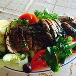 Our Fresh Tuna Steak served on a bed of salad