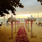 Wedding ceremony on beach in front of hotel