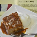 Traditional, moist bread pudding with warm maple sauce and ice cream...yum! Generous portion, to