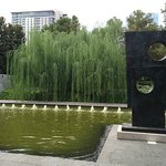 A sculpture by Barbara Hepworth in a fountain setting
