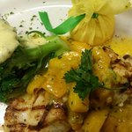 Grilled grouper with a mango beurre blanc.