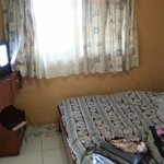 The room and its old style furniture and ancient TV that didnt really work