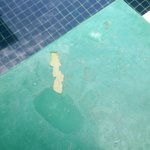 The peeling paint work on the flooring around the pool in one of the Srivijaya Pool Villa which