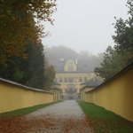 Looking through the mist toward the building of Hellbrunn Palace