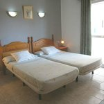 "Double room with air conditioning , 32 "" lcd TV, own bathroom , fridge , free wifi."