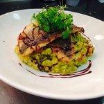 Wild sea bass with pea and chorizo risotto
