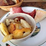 Meat, cheese, and delicious potatoes