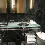 glass wash basin with a movable trolley
