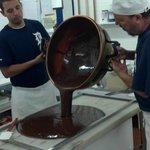 Pouring out a chocolate fudge.