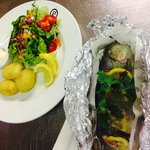 A Chefs Special whole trout with salad and baby potatoes