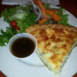 Perfection in Artichoke Quiche and salad with house sweet balsamic dressing