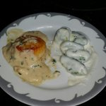 On one side a seared scallop in a tasy garlic mayonnaise sauce. The other spinnach gnocchi in a