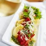Housemade Goat Cheese Ravioli with Pomodoro Sauce & Wild Arugula