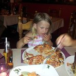 3 year old devouring adult size pizza!