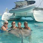 Holding our new stingray friend ...