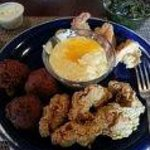 My shrimp, oysters, greens, and grits! YUM!!!