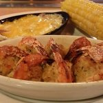 Crab stuffed shrimp with corn and smashed potatoes.