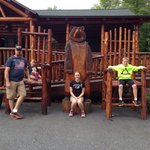 The family posing with the big chairs & bear before getting ready to gear up!