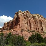Red roxk cliffs rising above the Box Canyon trail.