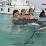 Girls about to kiss a stingray