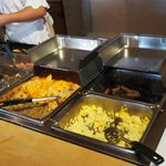 Hot dishes at the breakfast buffet: sausages, potatoes, and scrambled eggs when we stayed