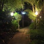 lush gardens along pathways through villas and to the beach