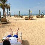beach-chairs far from waters edge