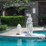 Lovely statue one of the water maidens around pool