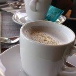 ็Hot cappuccino from Nescafe auto coffee machine