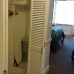 Double wide closet in the hall separating bedroom from bathroom