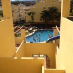 View from apartment staircase to the middle pool