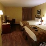 2 nice comfortable beds and the tv area.