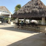Bar at Grand pool area, swim up bar on other side, with Carabenos buffet to the left, rooftop lo