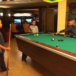 Kids playing pool in the lobby