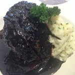 Confit of lamb in a reduction sauce with mashed potatoes