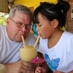 Husband and daughter enjoying a smoothie