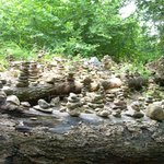 Lots of stacked rocks in river bed