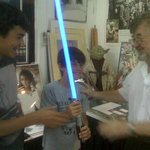 Holding Nick's light saber, notice Yoda in the background.