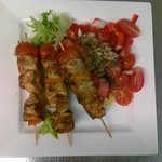 Spicy Chicken Mediterranean Kebabs with tomato, onion and basil side
