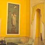 Heavy drapes and decor was yellow and blues throughout