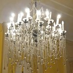 Well lit recpetion rooms, with chandeliers