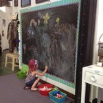 Kids playing at the chalkboard