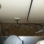 Behind the Nightstand; note electrical outlet