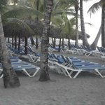 A view of the beach and seating area of the Bahia Principe Resort
