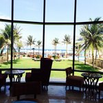 In the lobby area. It has an amazing view of the pool/beach.